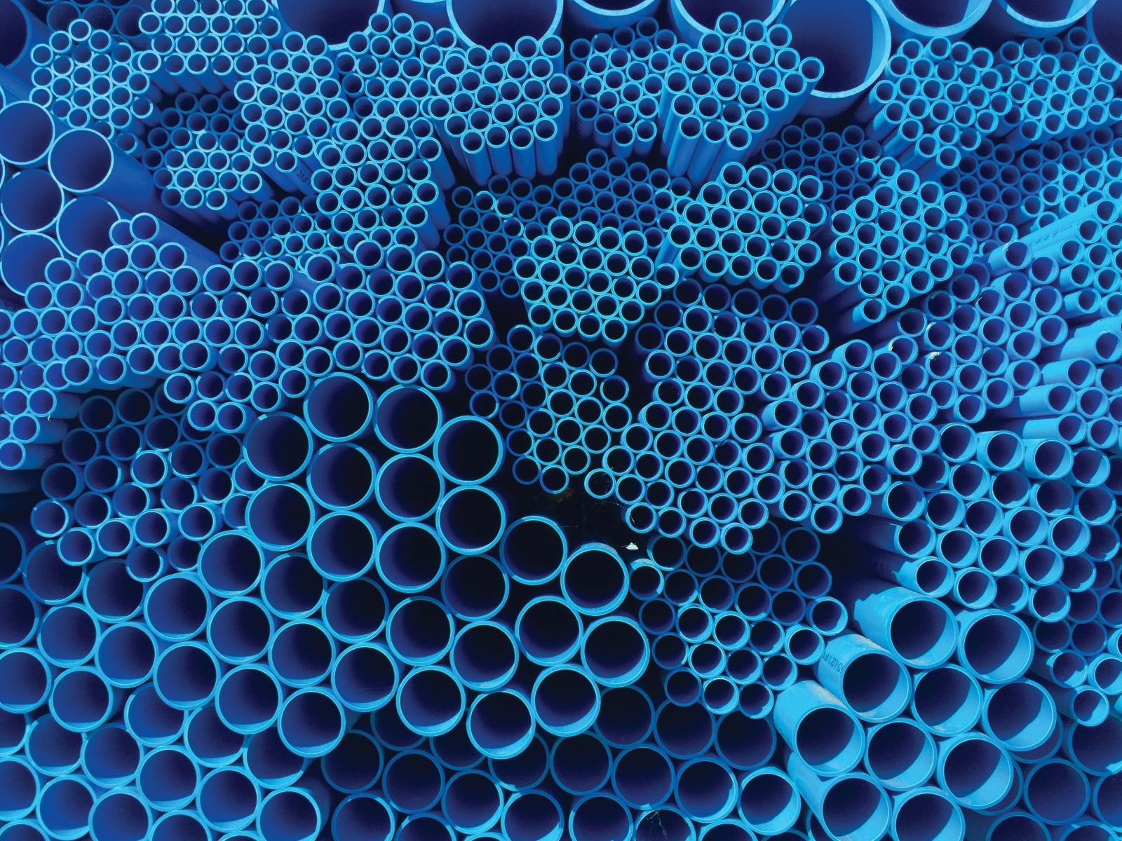 Figure 2: Sections of Mixed Size Blue PVC Pipes (Photo by Narongchai Sriarunniran, via Shutterstock.)