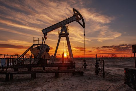 Oil pump rig. Oil and gas production. Oilfield site. Pump Jack are running. Drilling derricks for fossil fuels output and crude oil production. Global coronavirus COVID 19 crisis. War on oil prices.